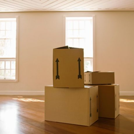 4 Boxes in an empty room while moving